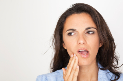 Woman in need of gum disease treatment in Schererville, IN.